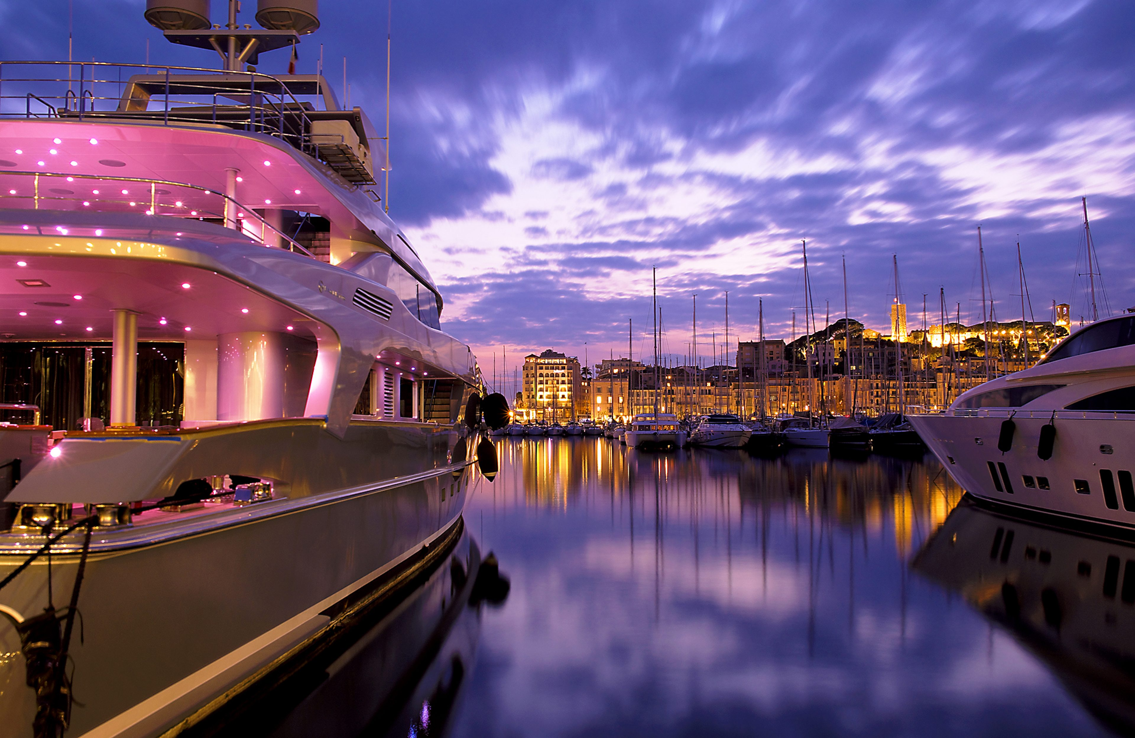 Boat in Cannes harbour by night