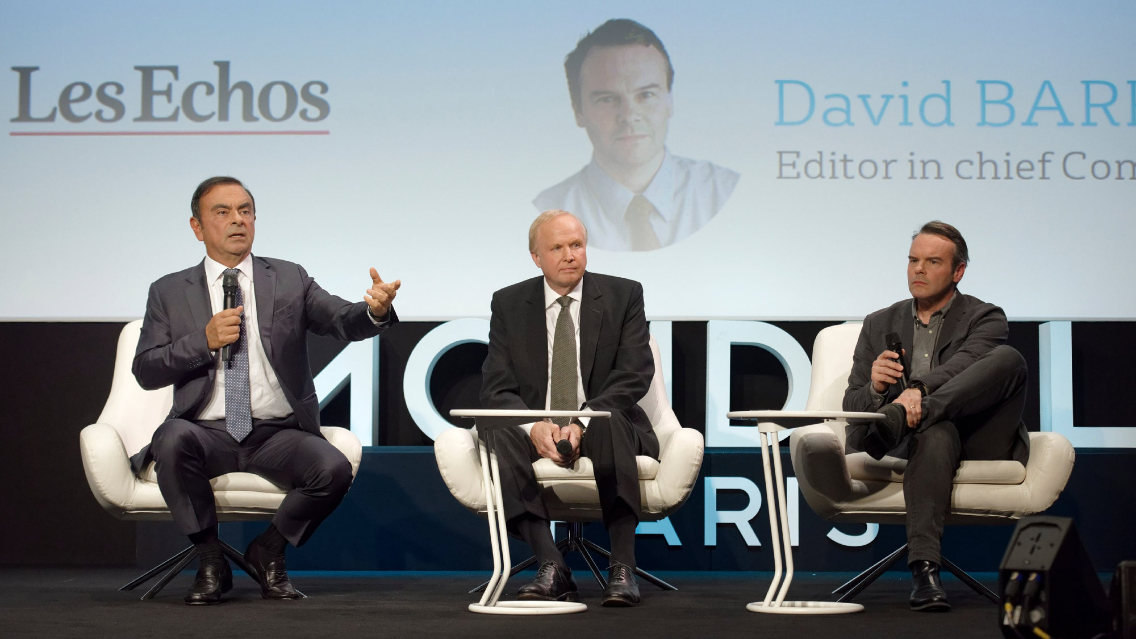 BP CEO Bob Dudley shares the stage with Carlos Ghosn, chairman and CEO of the Renault Nissan Mitsubishi Alliance, left, and David Barroux, editor in chief, companies section for Les Echos, right, at the Paris Motor Show