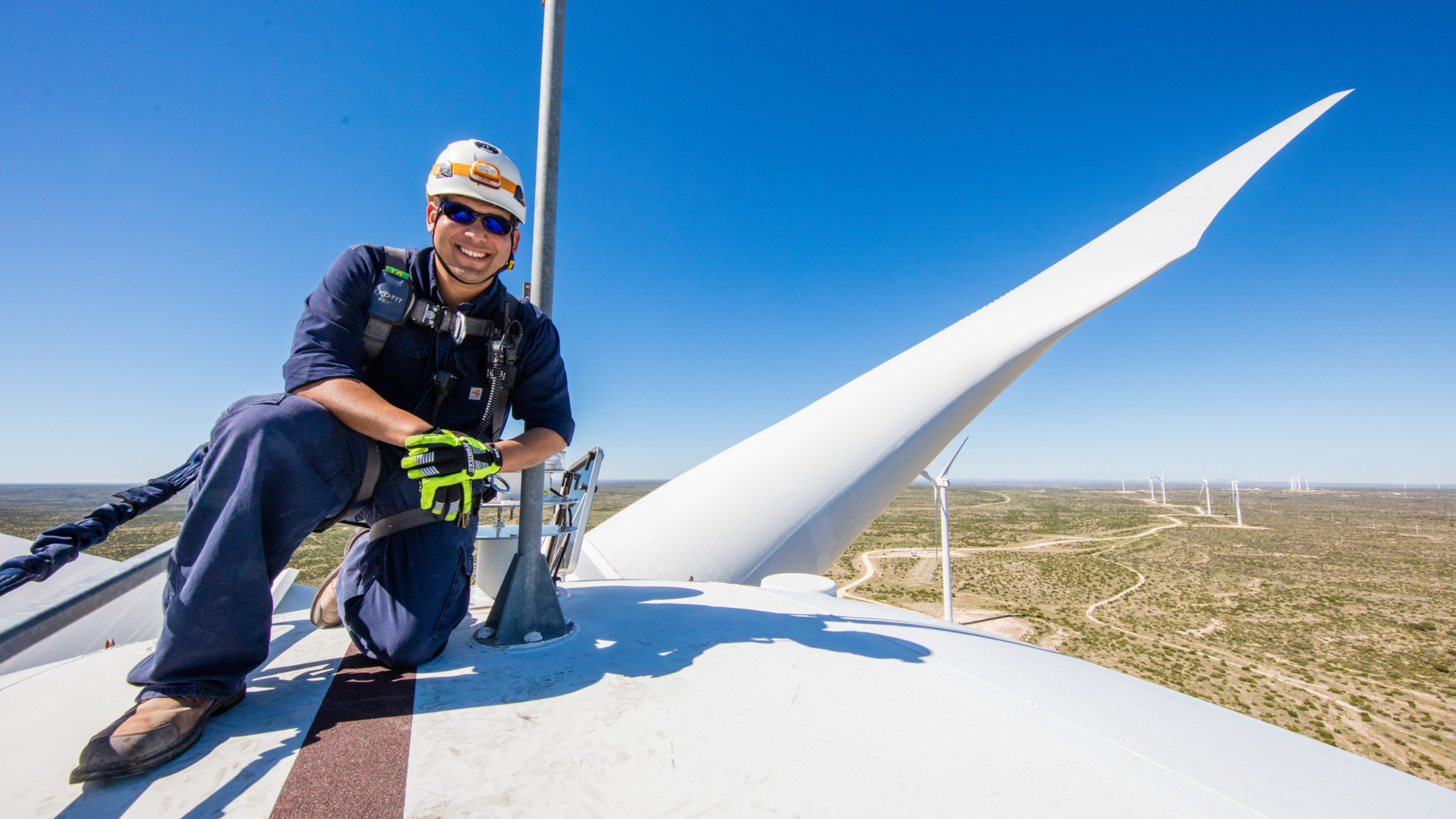 BP facility manager on a wind turbine in Sherbino 2 wind farm, West Texas, US