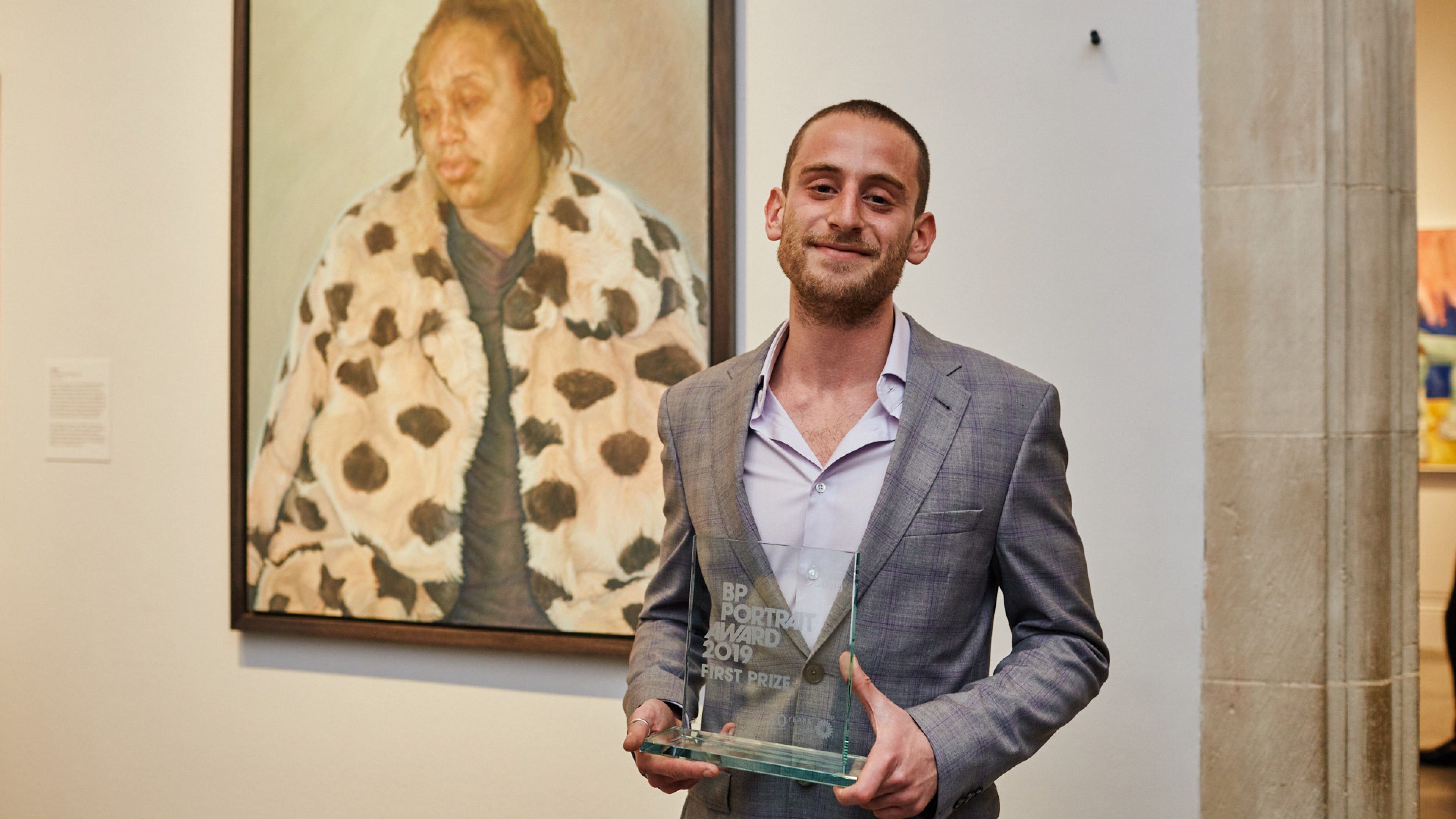 Artist Charlie Schaffer, winner of the BP portrait award 2019 in front of his painting, Imara in her Winter Coat