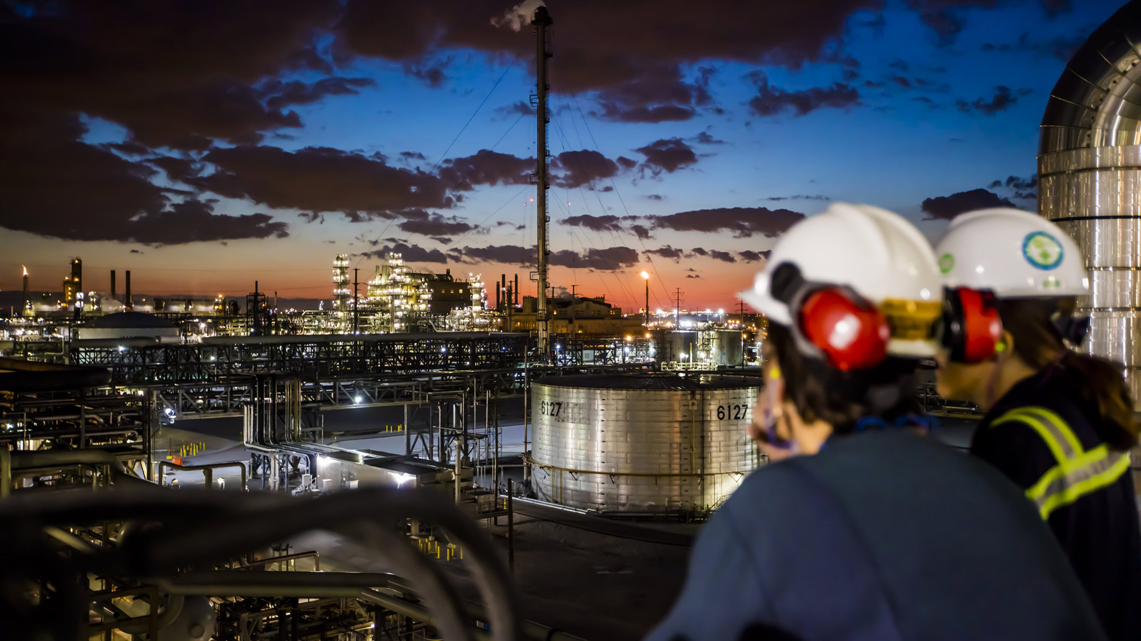 Operators look across BPs Whiting Refinery in Indiana, US, at sunset