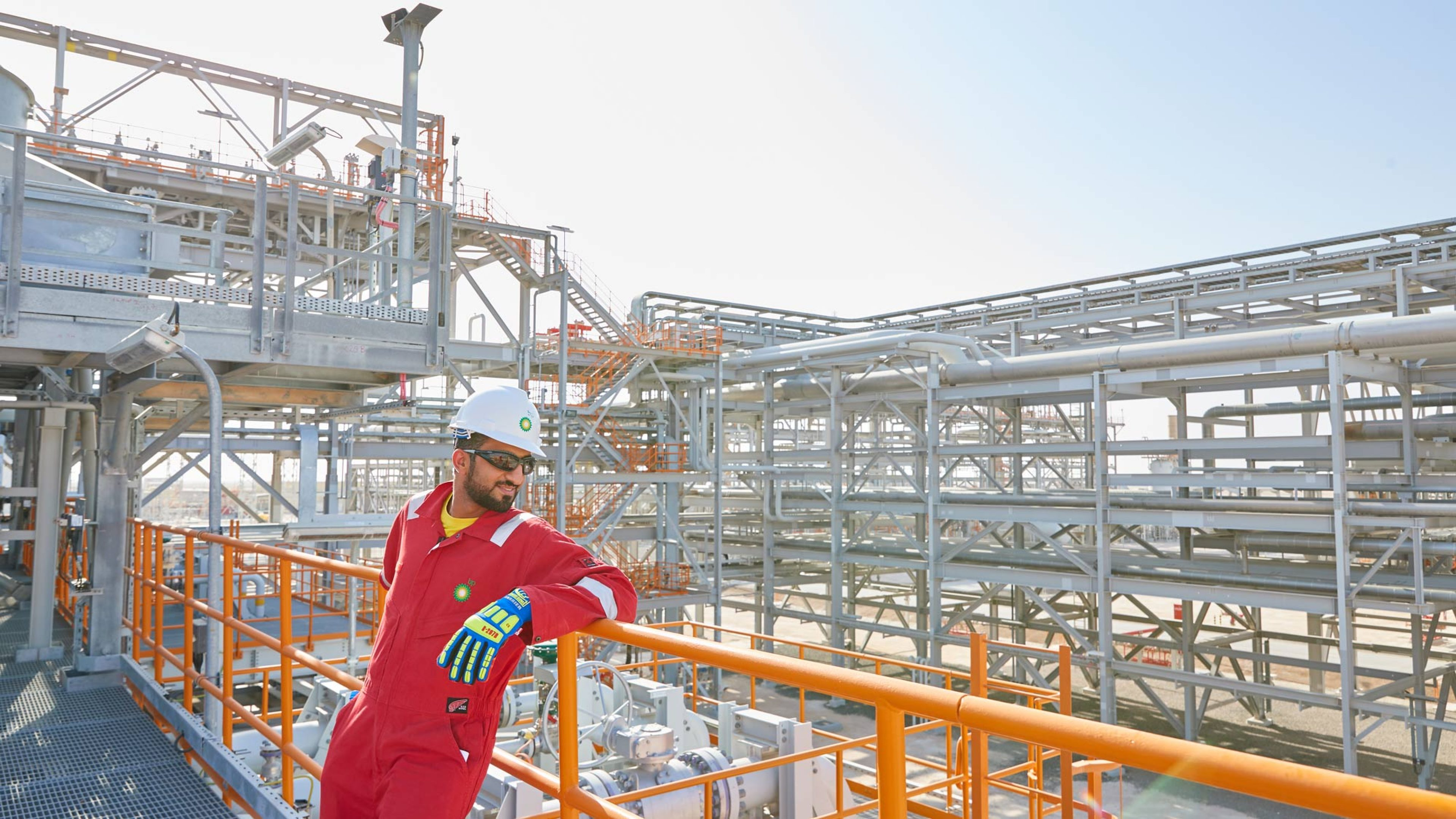 A BP Oman worker against a view across BP's Khazzan central processing facility