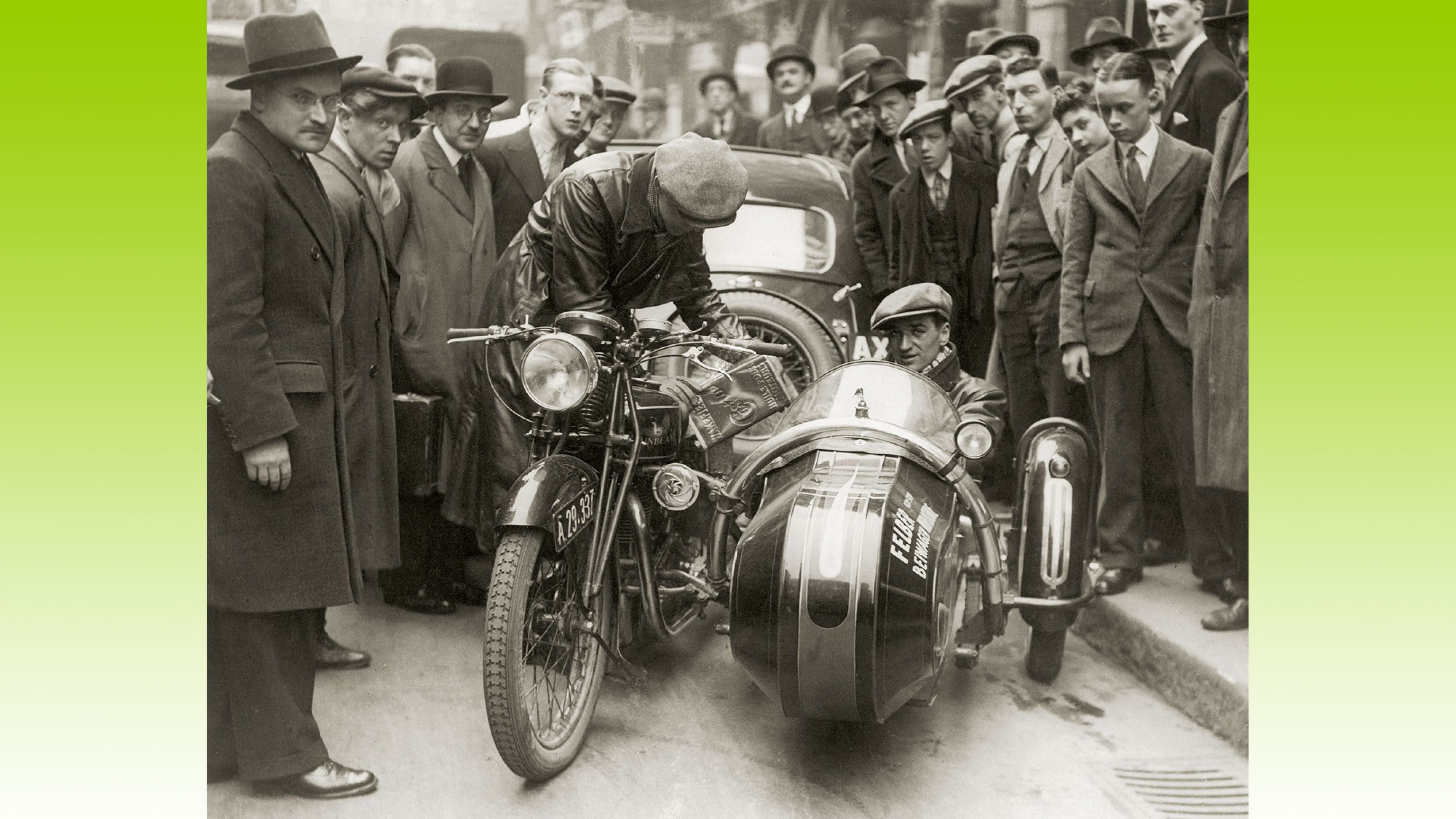 Crowds gather around a motorcycle as it is filled with Castrol lubricant, on its record-breaking drive from Vienna to Ostend in 1934