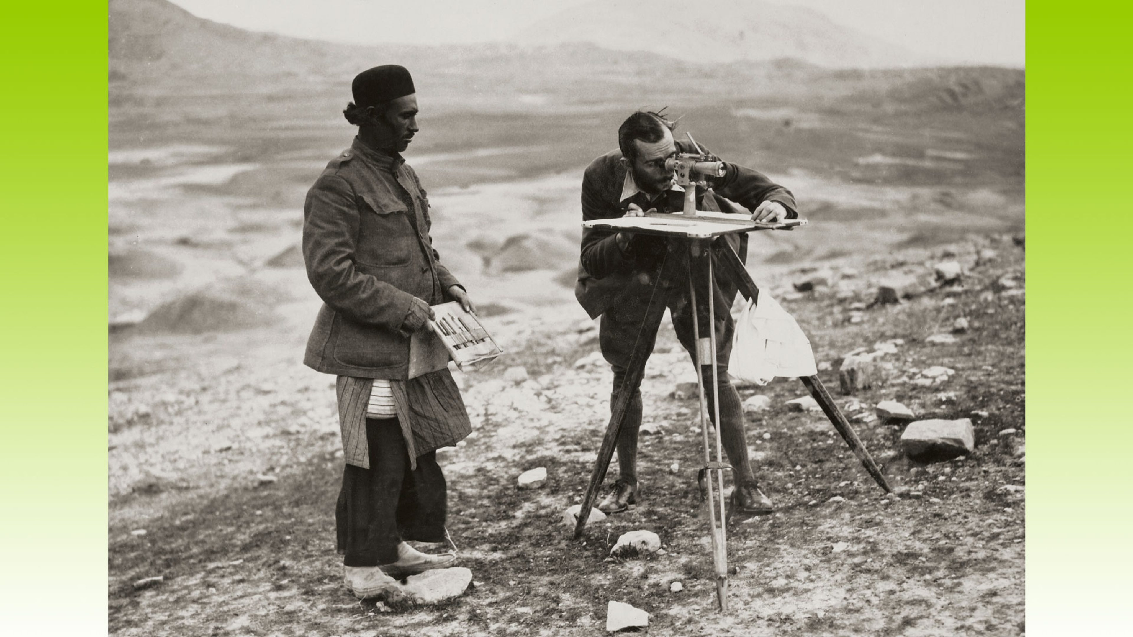 A BP geologist using instruments to conduct a survey in Persia, 1926. A local guide stands by his side