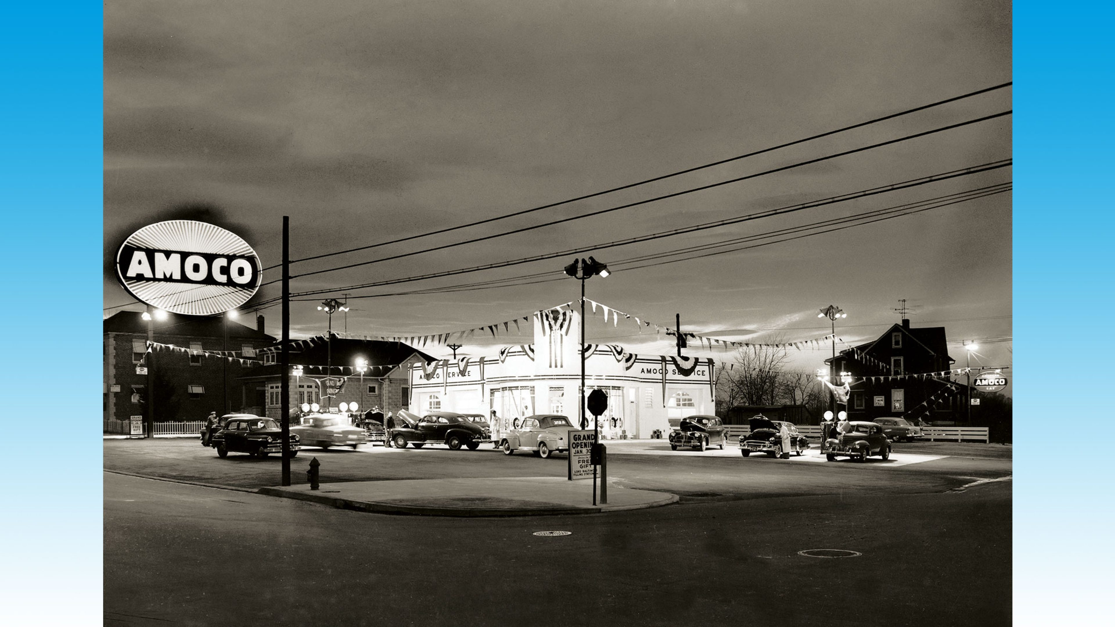 The opening of a new Amoco service station near Baltimore, US, in 1953. Bunting lines the car park, directly in front of the illuminated store