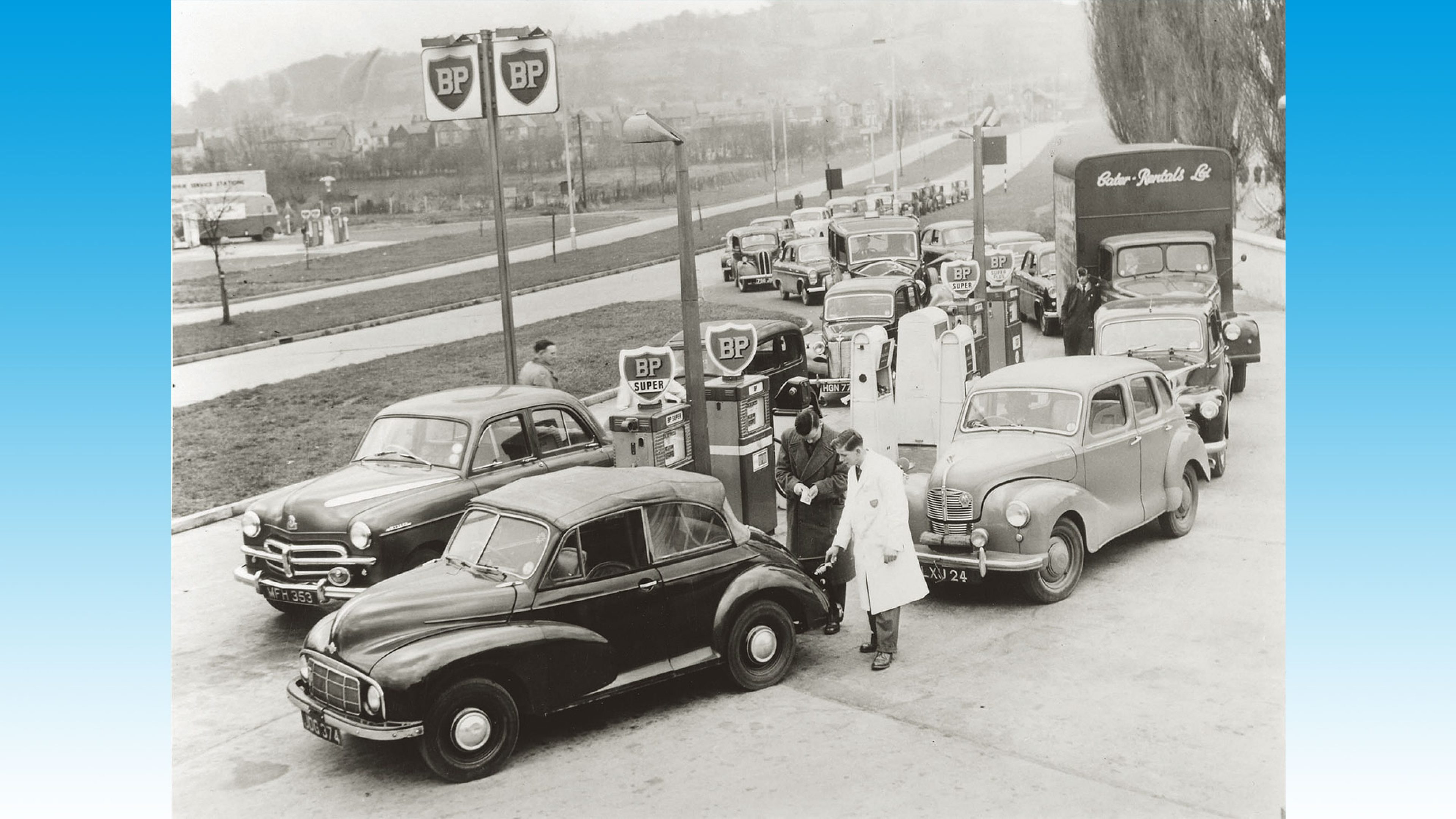 Motorists queuing for rationed petrol in the UK, following the closure of the oil supply route through the Suez Canal in 1956