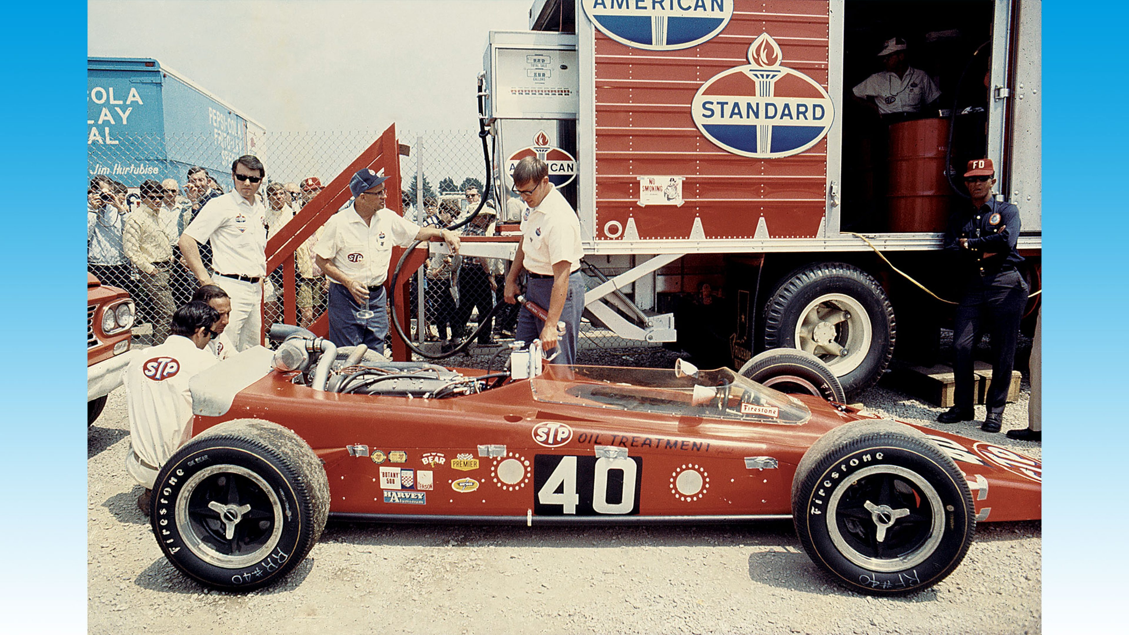 Fuelling the victorious Mario Andretti's Hawk-Ford with Standard fuel at the 1969 Indy 500