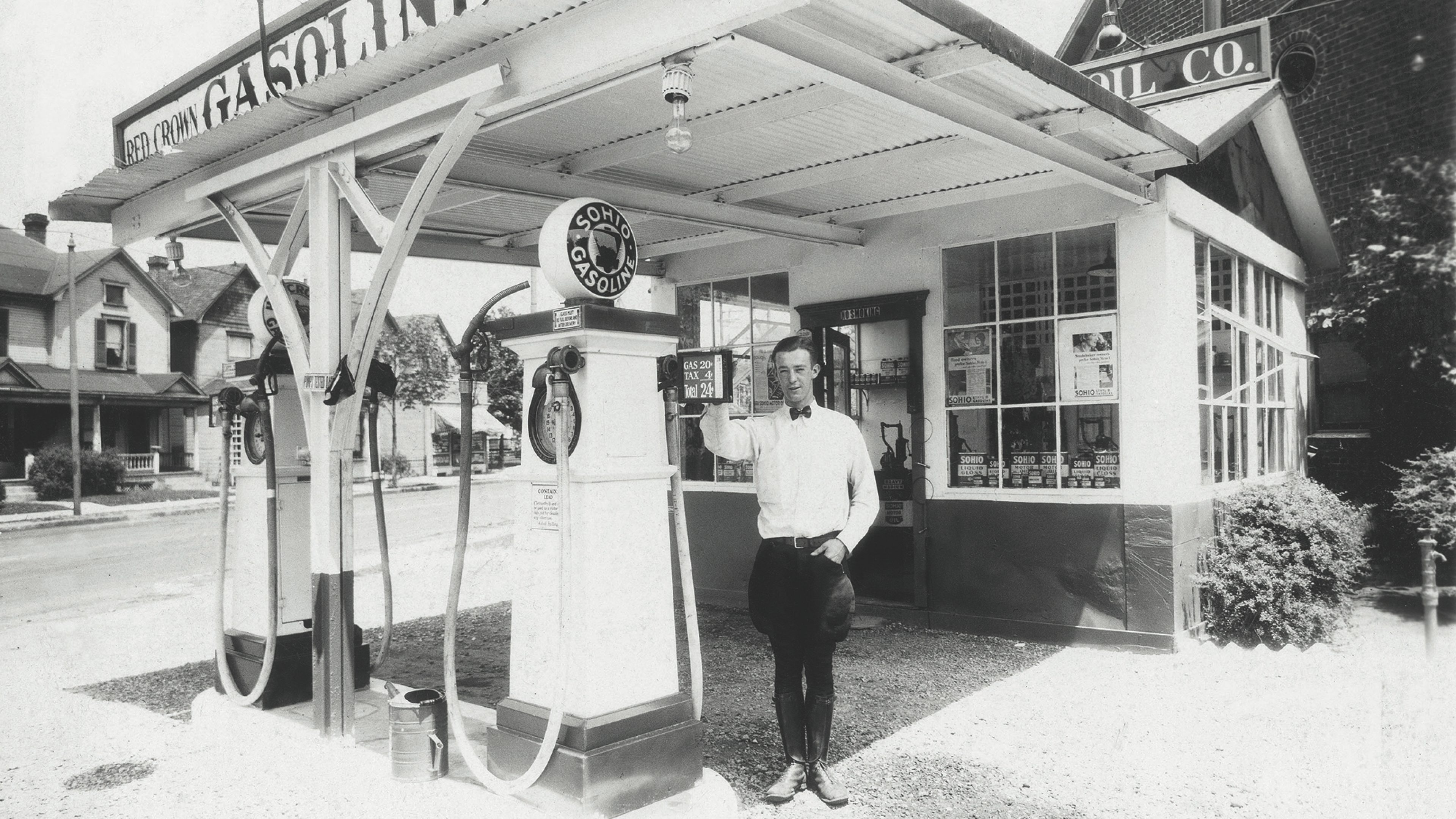 A person standing on the forecourt of an old Sohios service station.