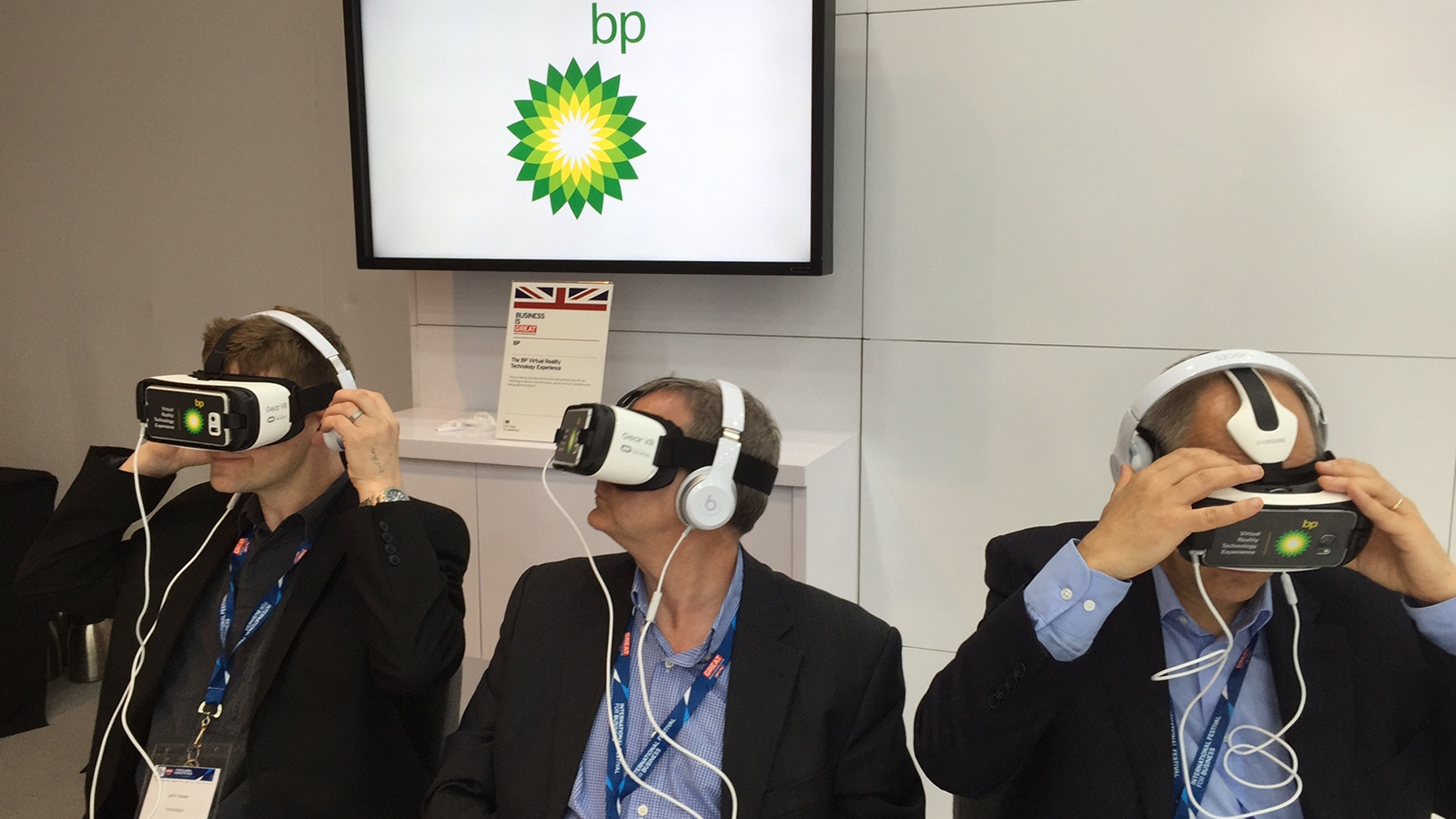 Three men wearing virtual reality headsets
