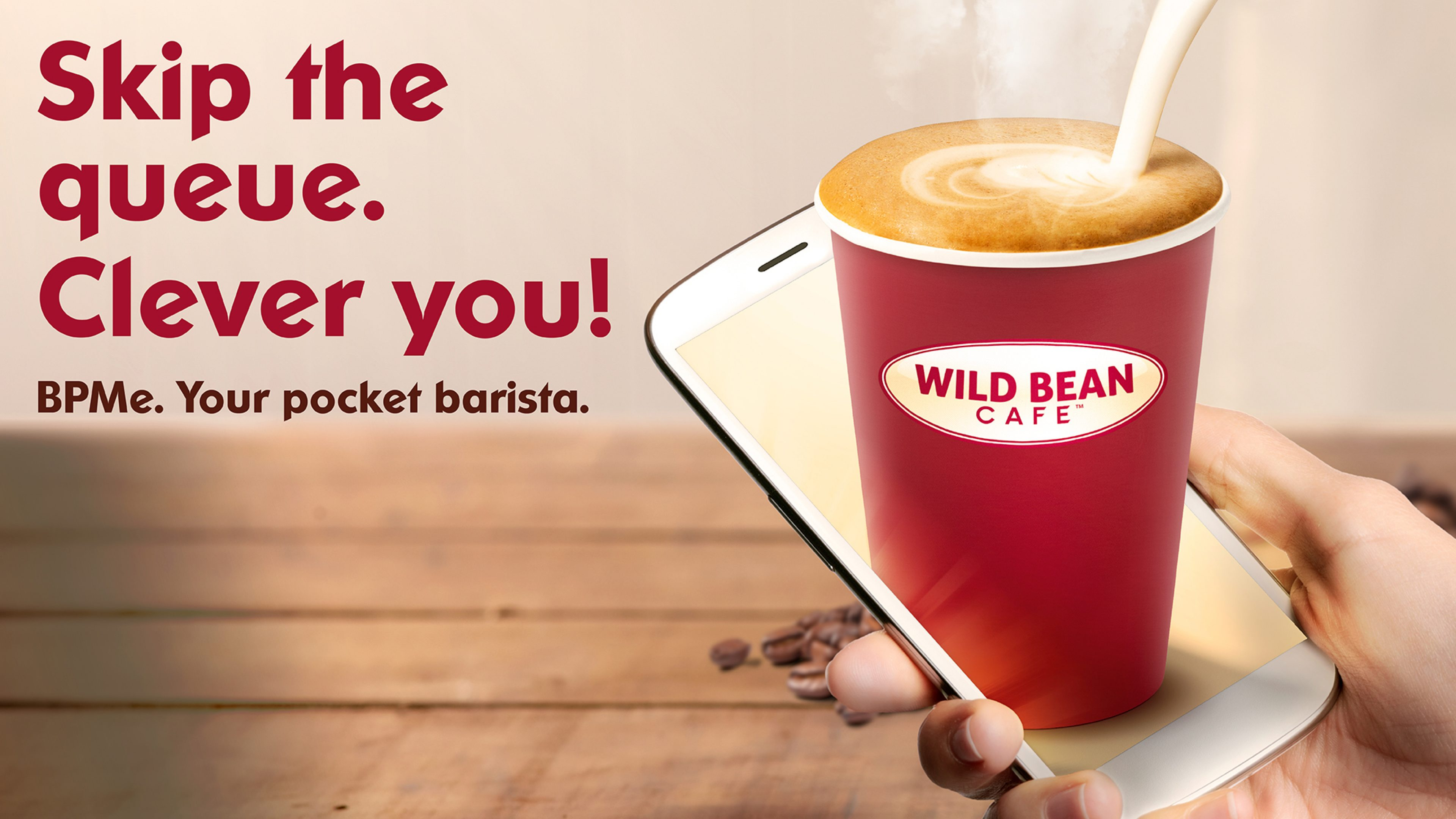 Skip the queue words with Wild Bean Cafe cup and phone