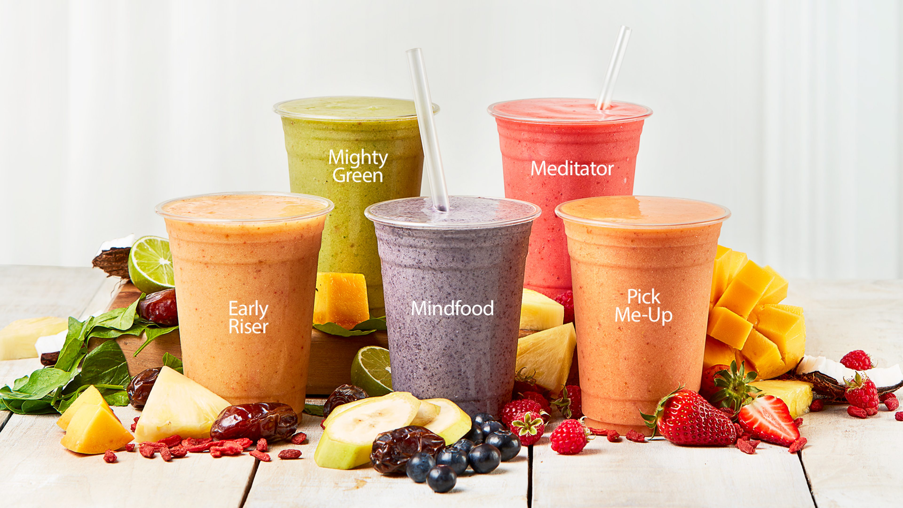Wild Bean Cafe smoothies surrounded by fresh fruit