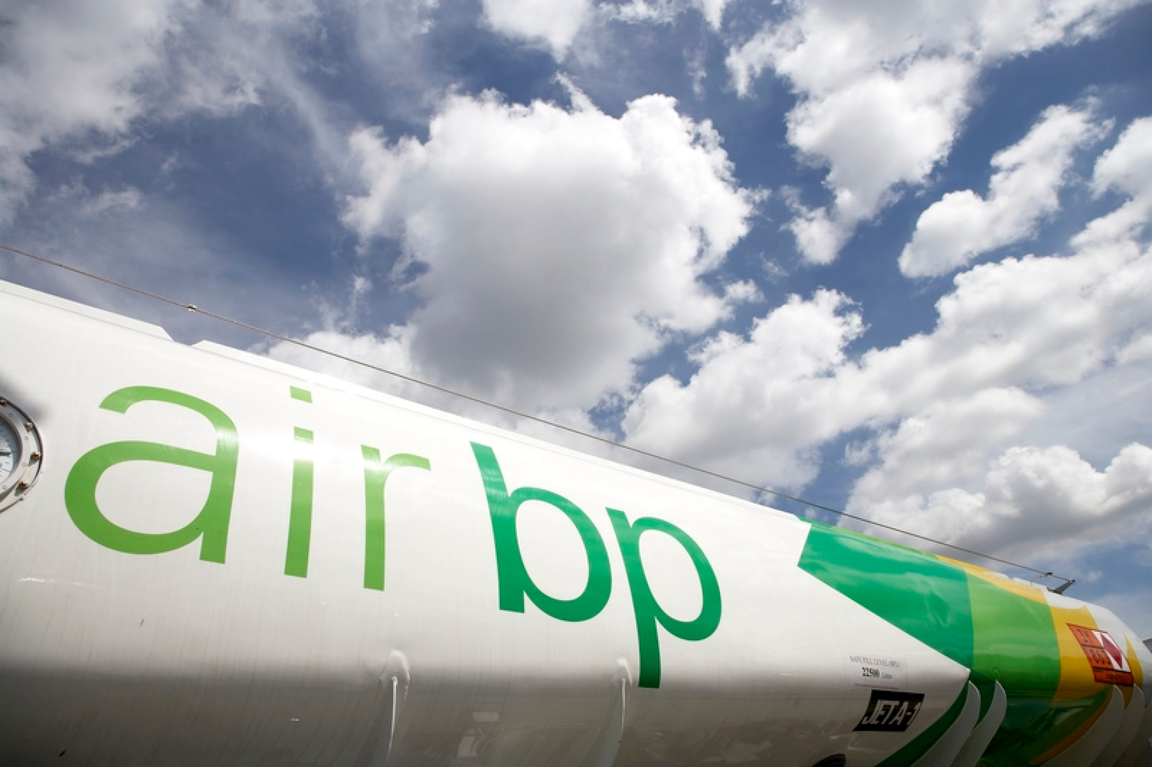 Air BP Branded Refuelling Vehicle in front of blue sky. London City Airport, UK.