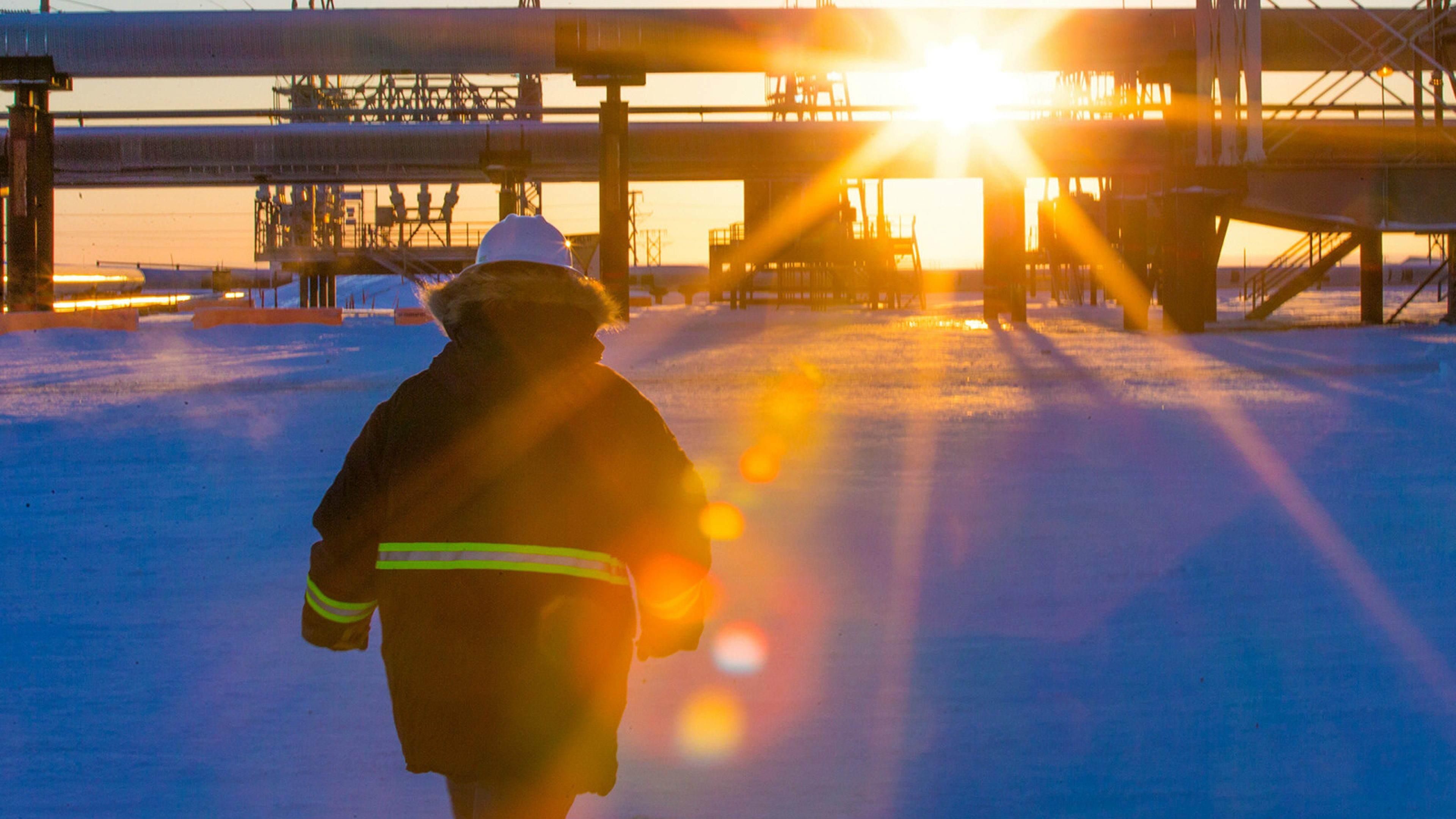 Facility Operator standing in the snow at Prudhoe Bay on the North Slope of Alaska, USA.