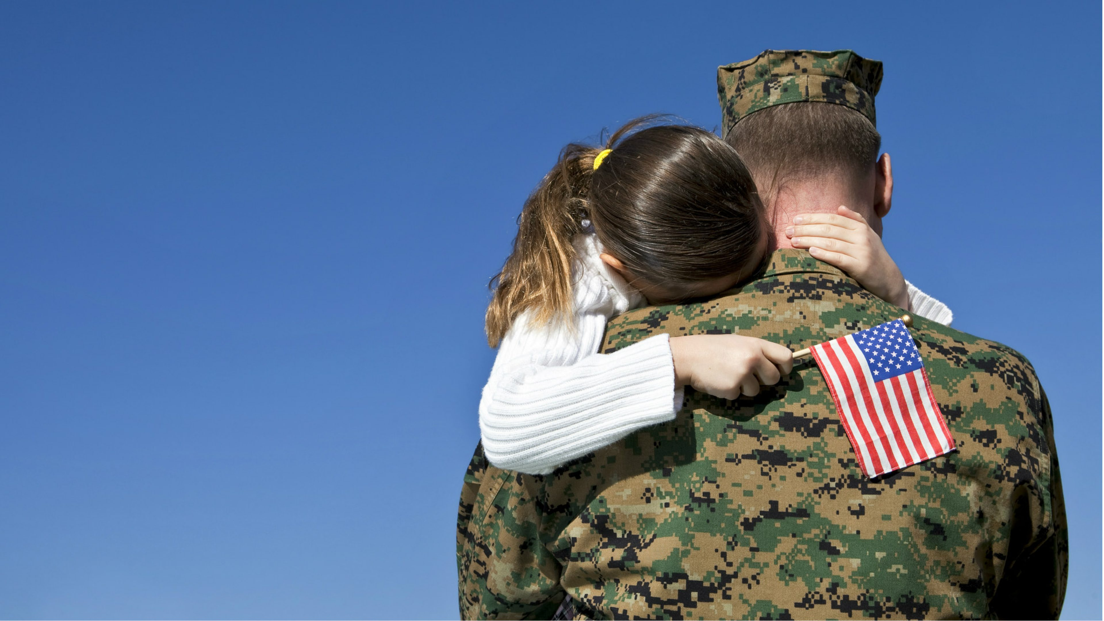 Girl hugging serviceman