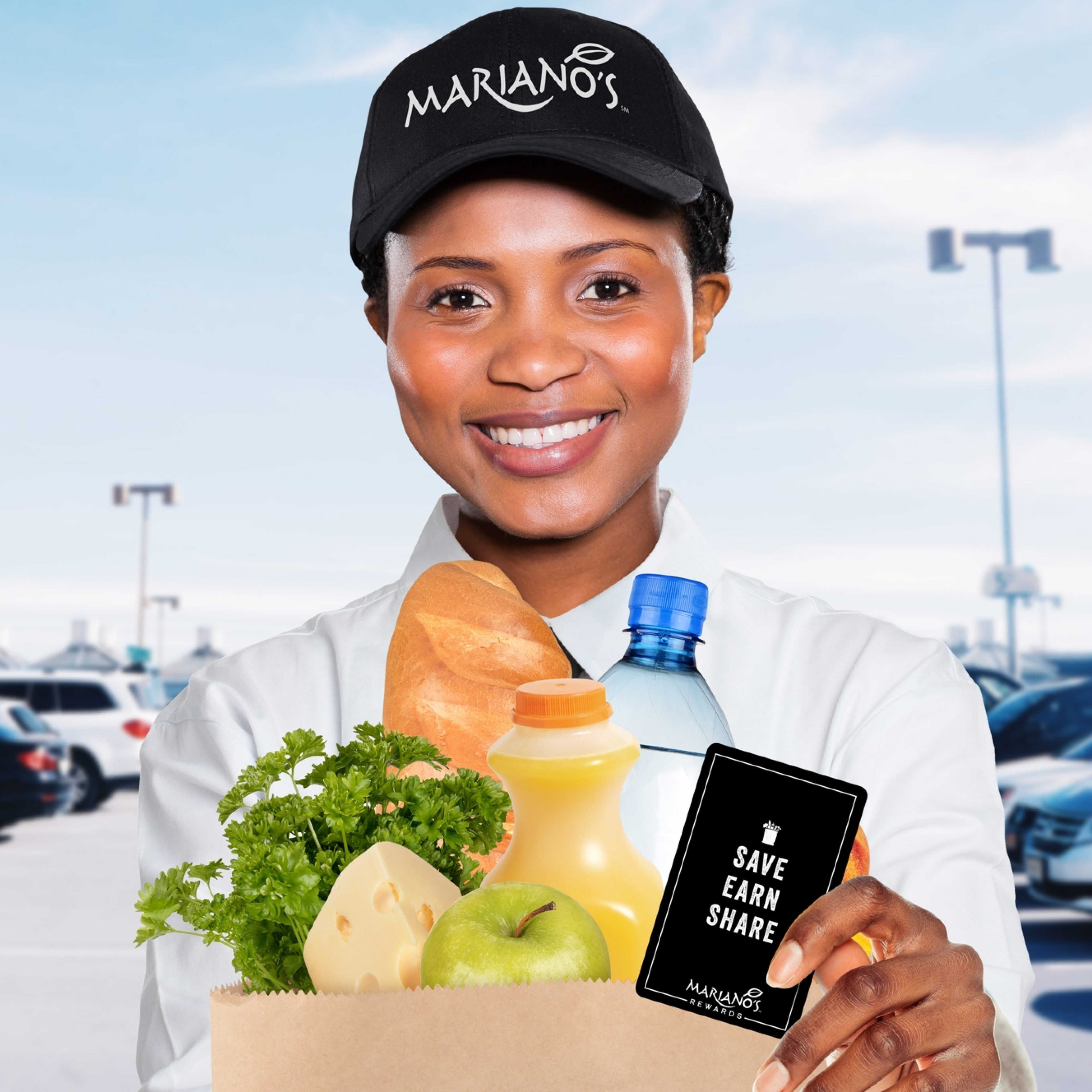 Mariano's worker holding a Save Earn Share card