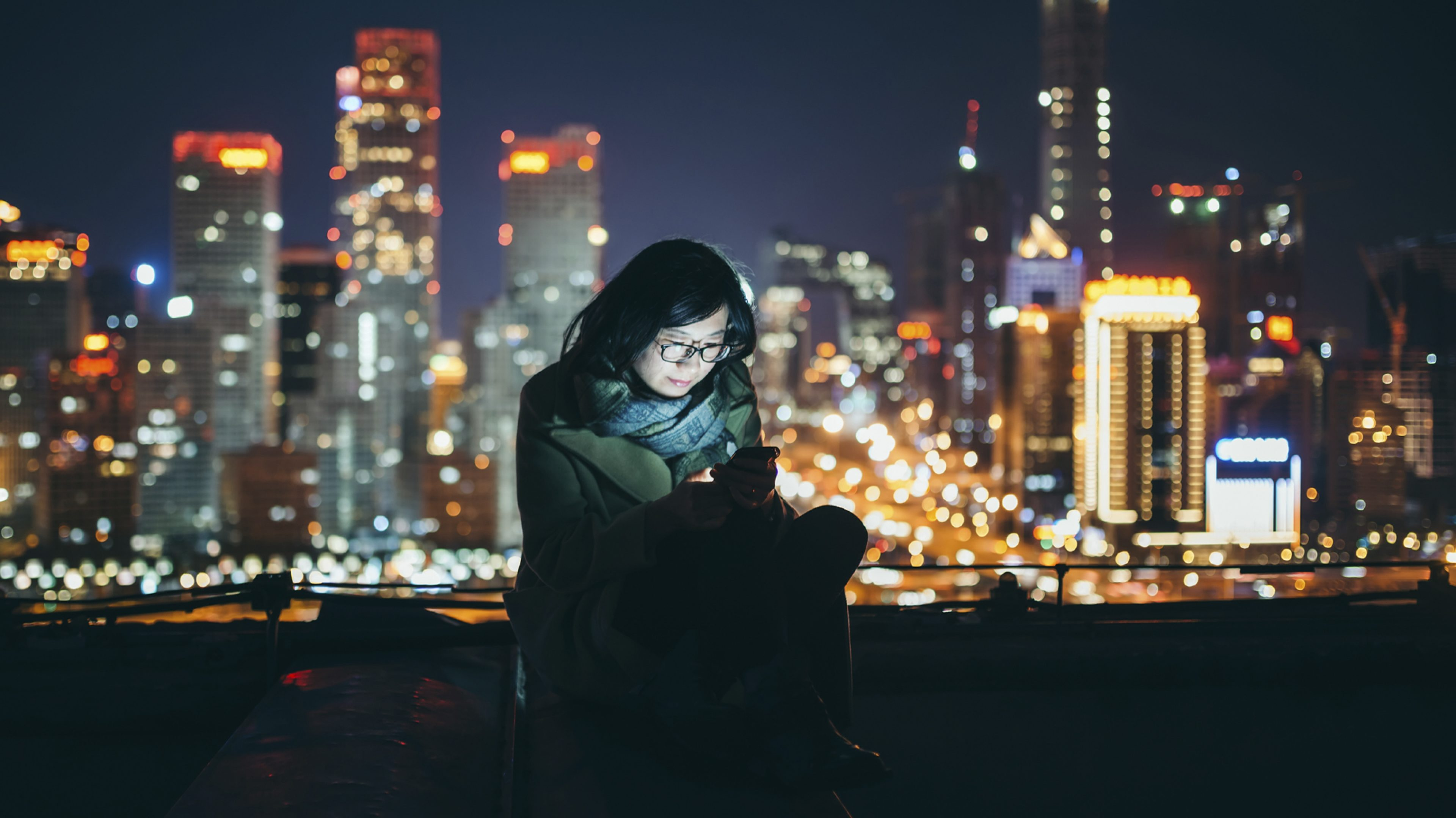 Woman using phone, on rooftop